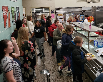 Families in line for a meal.