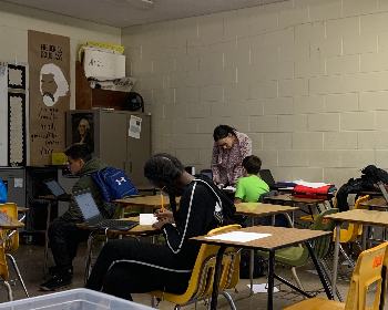 Students at desks doing homework.
