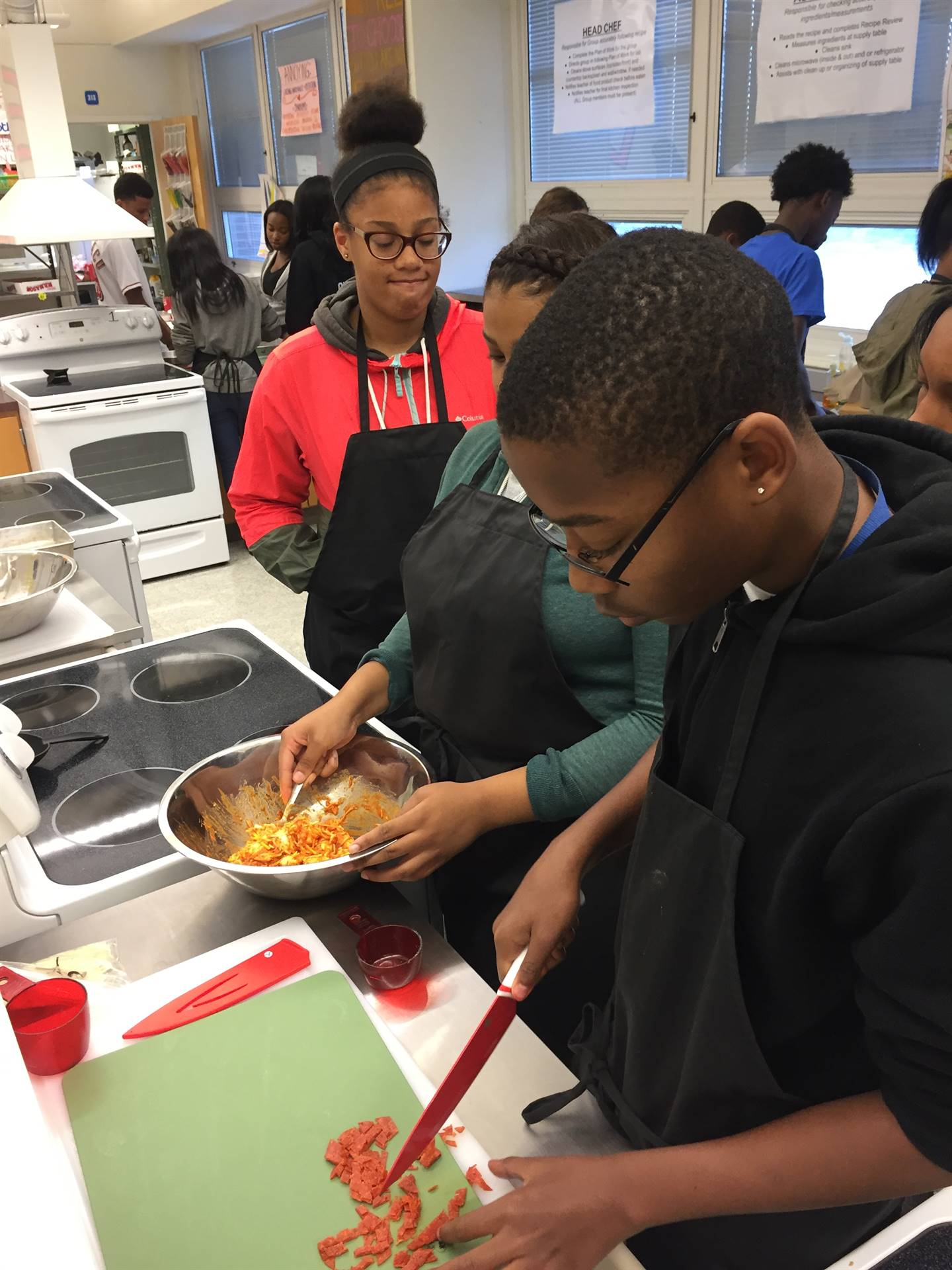 food tech students making pizza bubble bread