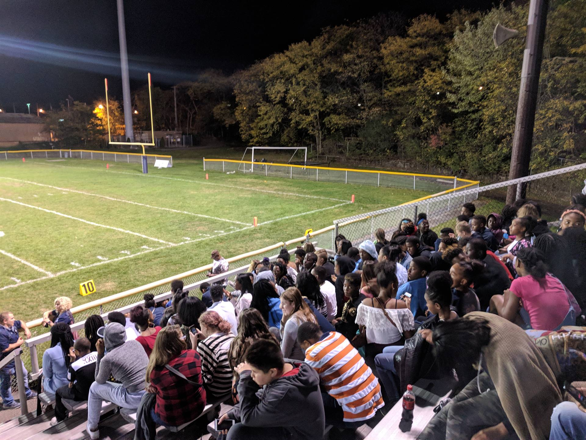 students at the football game after the dance