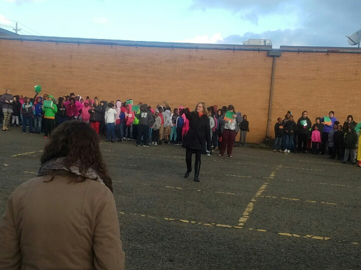 Gathering at Pet Supplies lot to ensure all students were accounted for