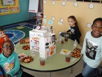 students eating snacks during the Halloween party