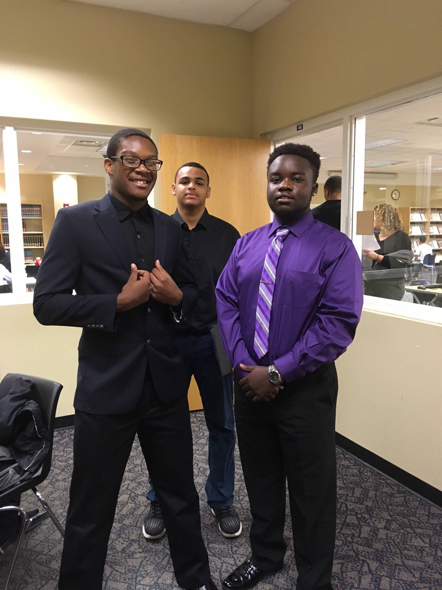 students dressed in suits and ties for mock interviews