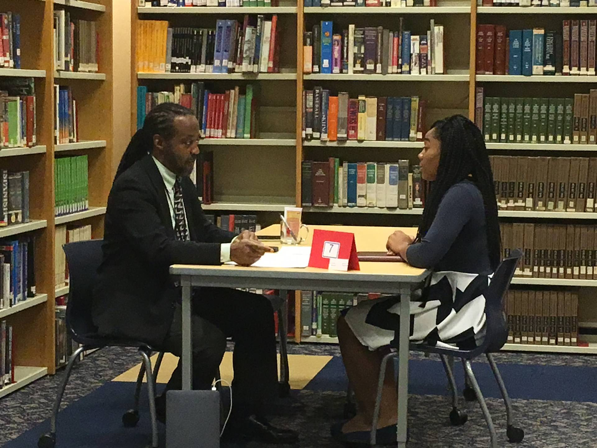 a female student being interviewed by a businessman