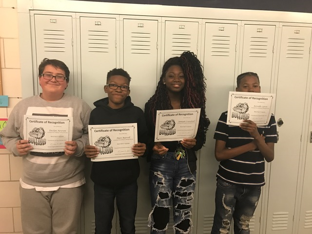students with Honor Roll and Merit Roll certificates