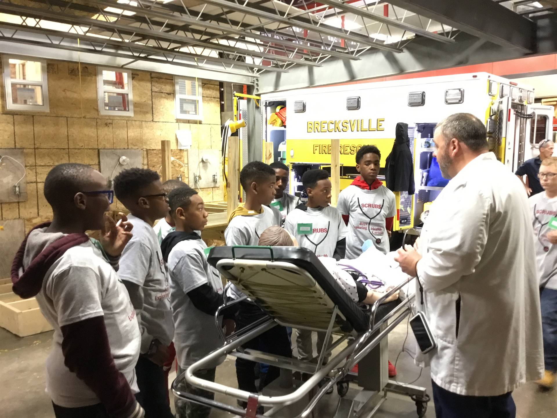 students with hospital equipment