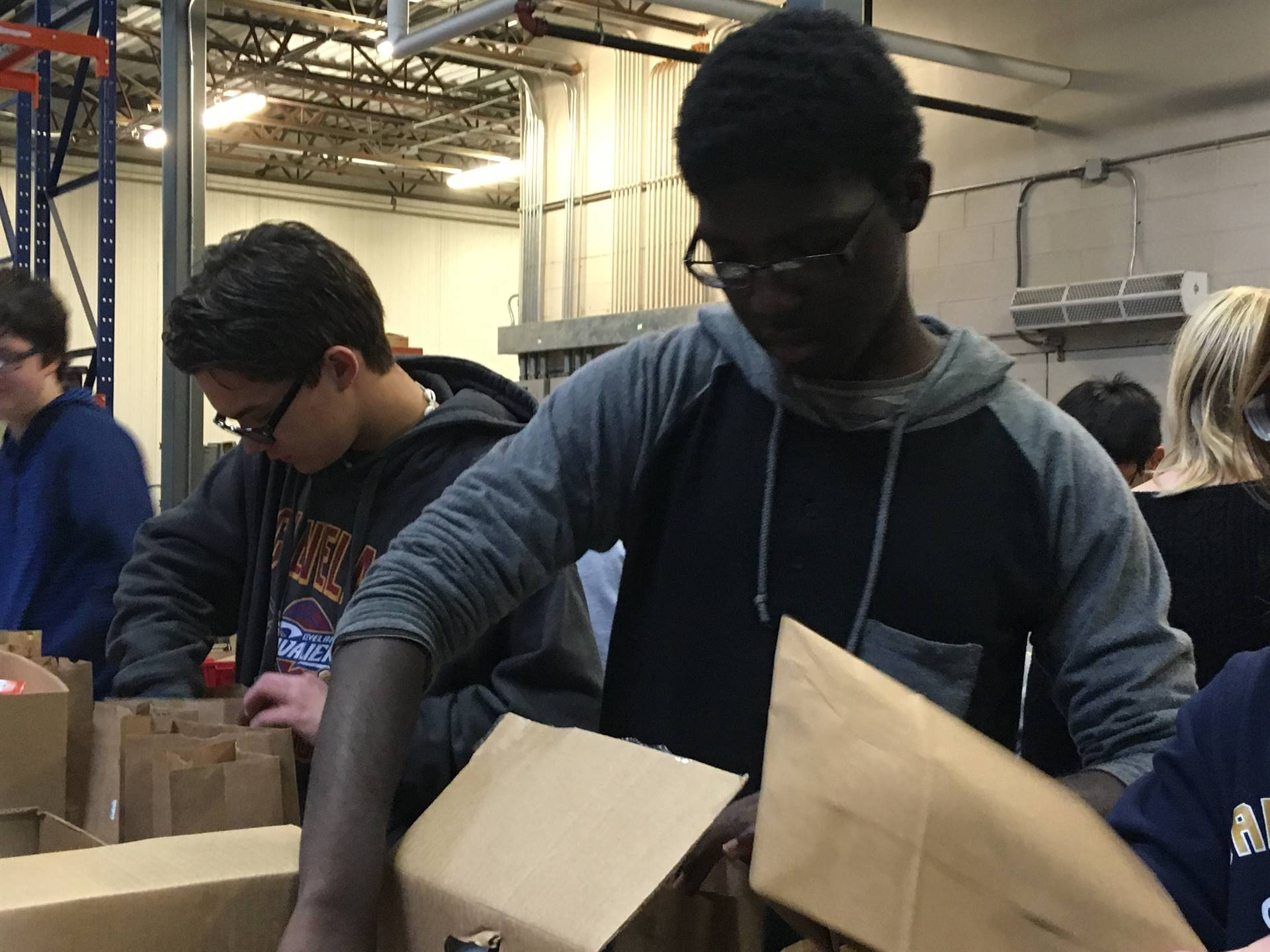 students packing boxes
