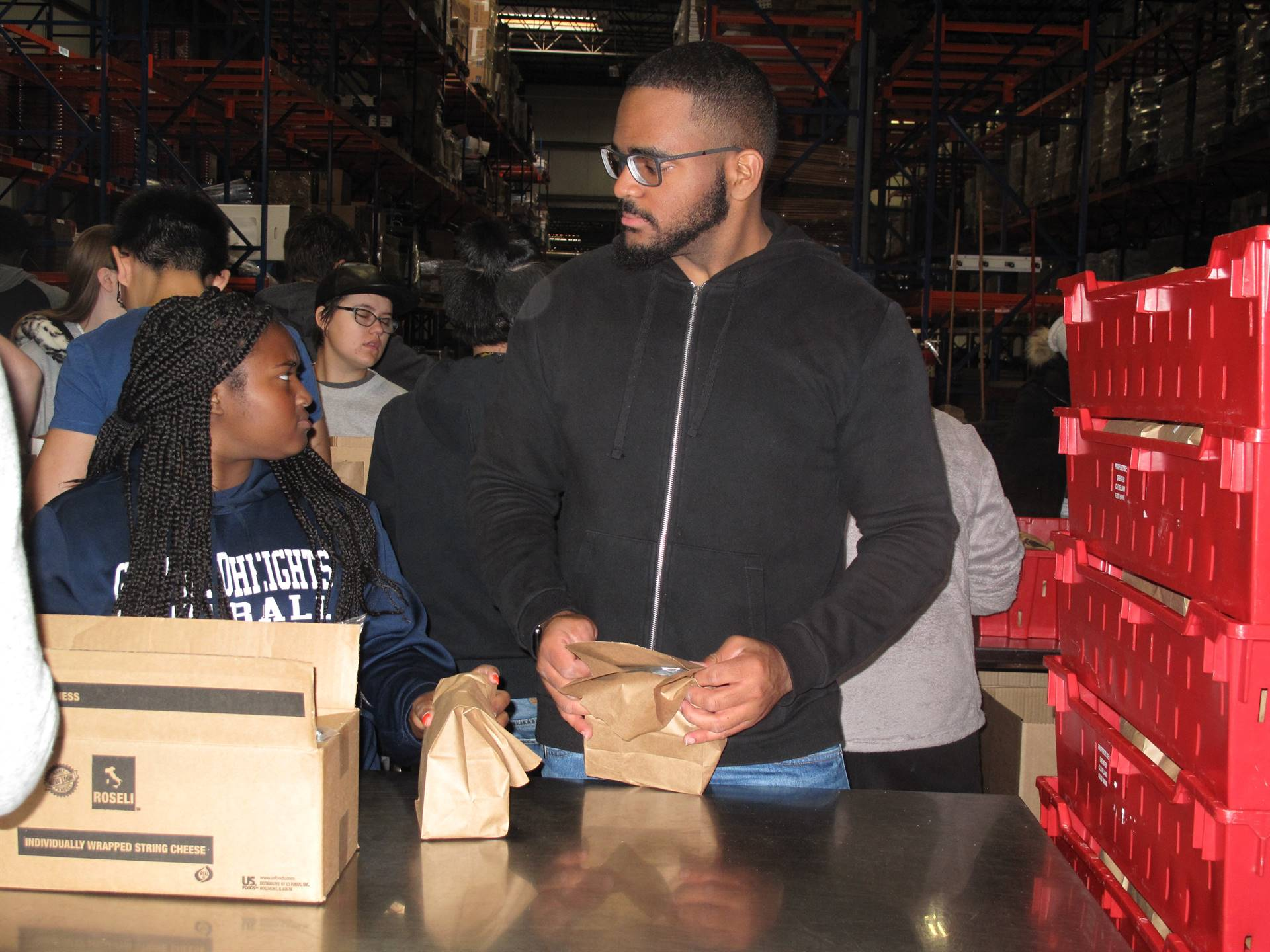 students stacking food boxes
