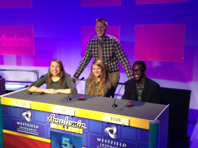 the academic challenge team and coach on set at channel 5