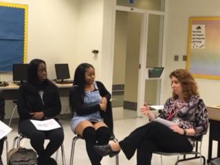 students talking to Lisa Ryan