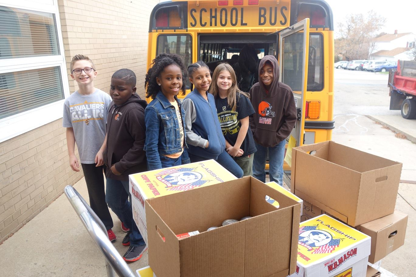 students with several boxes of canned goods