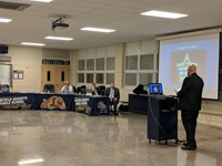 Chris Sauer presenting to the board of education