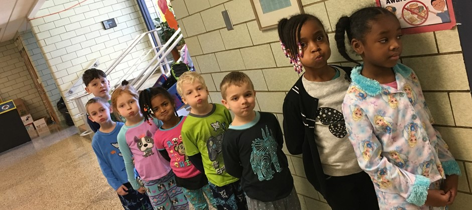 For the last several weeks students have been working on Elmwood's PAWS expectations in the hallway. Here we have our first grade students demonstrating hallway PAWS as they wait to go into the lunchroom.