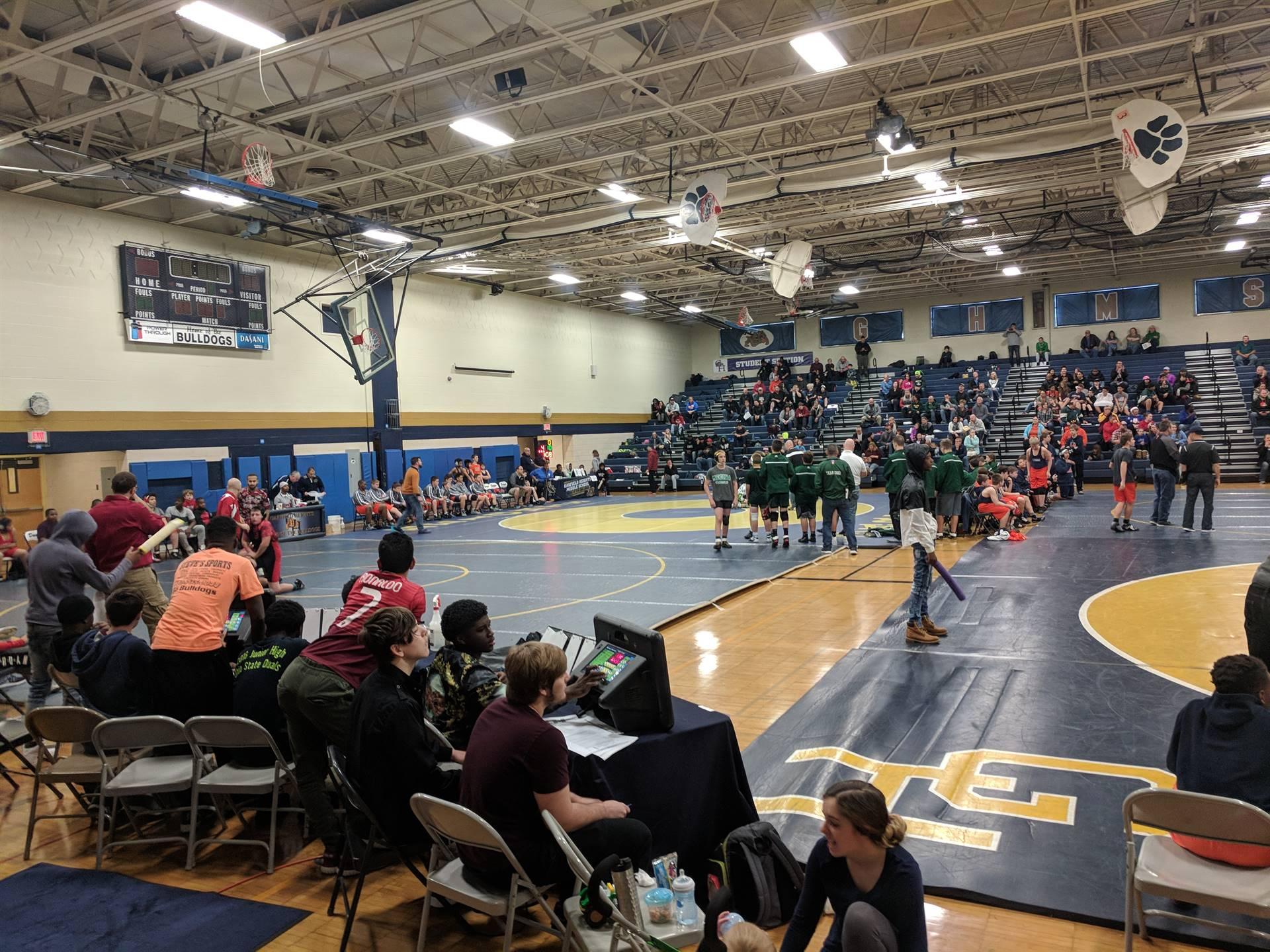 wrestling teams on the floor