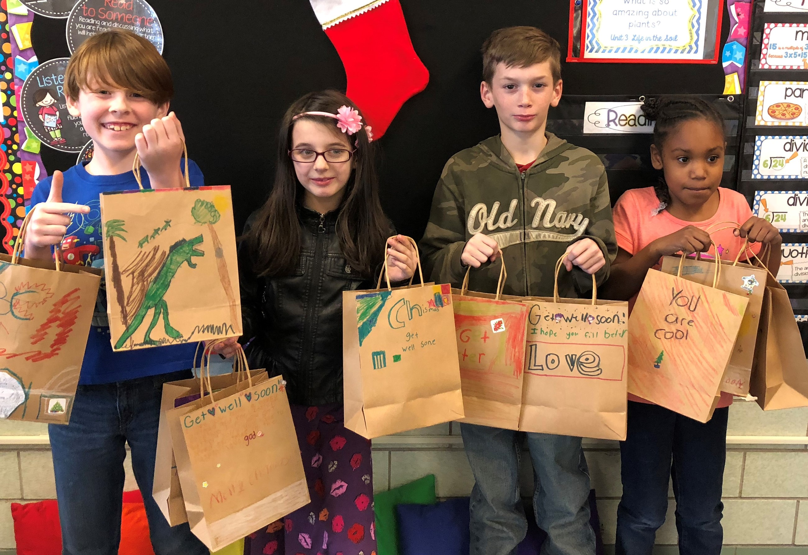 During the month of November, we learned about and modeled the character trait of gratitude and giving back. Our students were able to help make scarves and decorate gift bags, which will be given to patients at Akron Children's Hospital. I am very proud of the hard work and effort our students put in to brightening the holiday season for other children who may not be able to go home for Christmas. Thought I'd share something positive! :-)