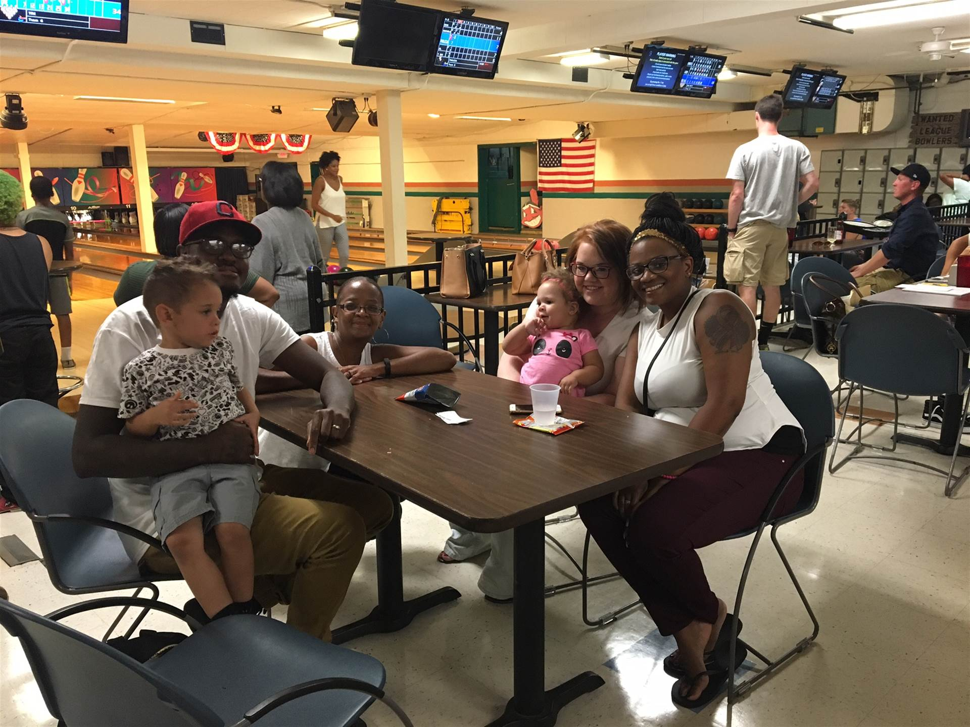 Families enjoying cosmic bowling