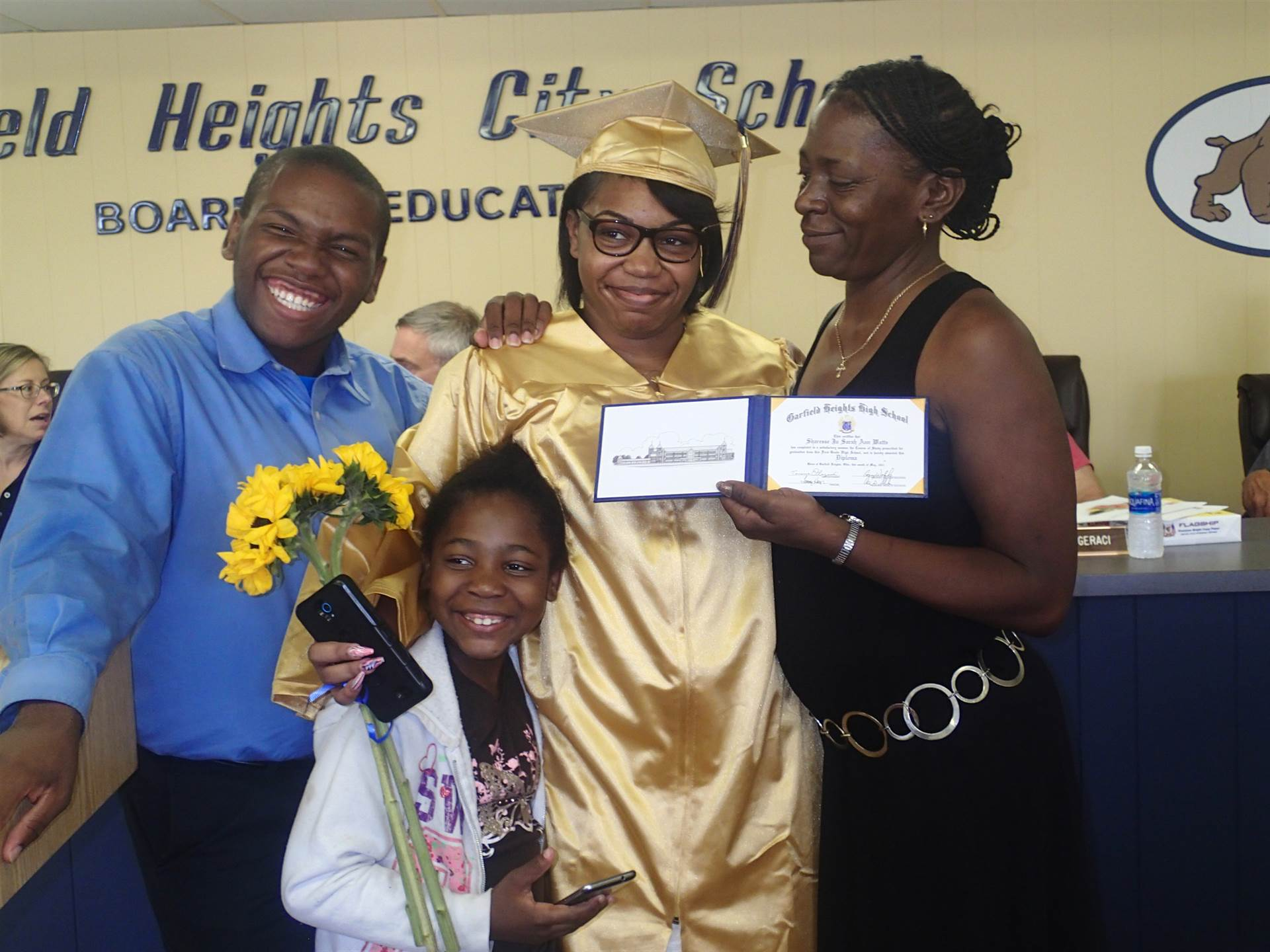 Sharesse Watts and family at her graduation