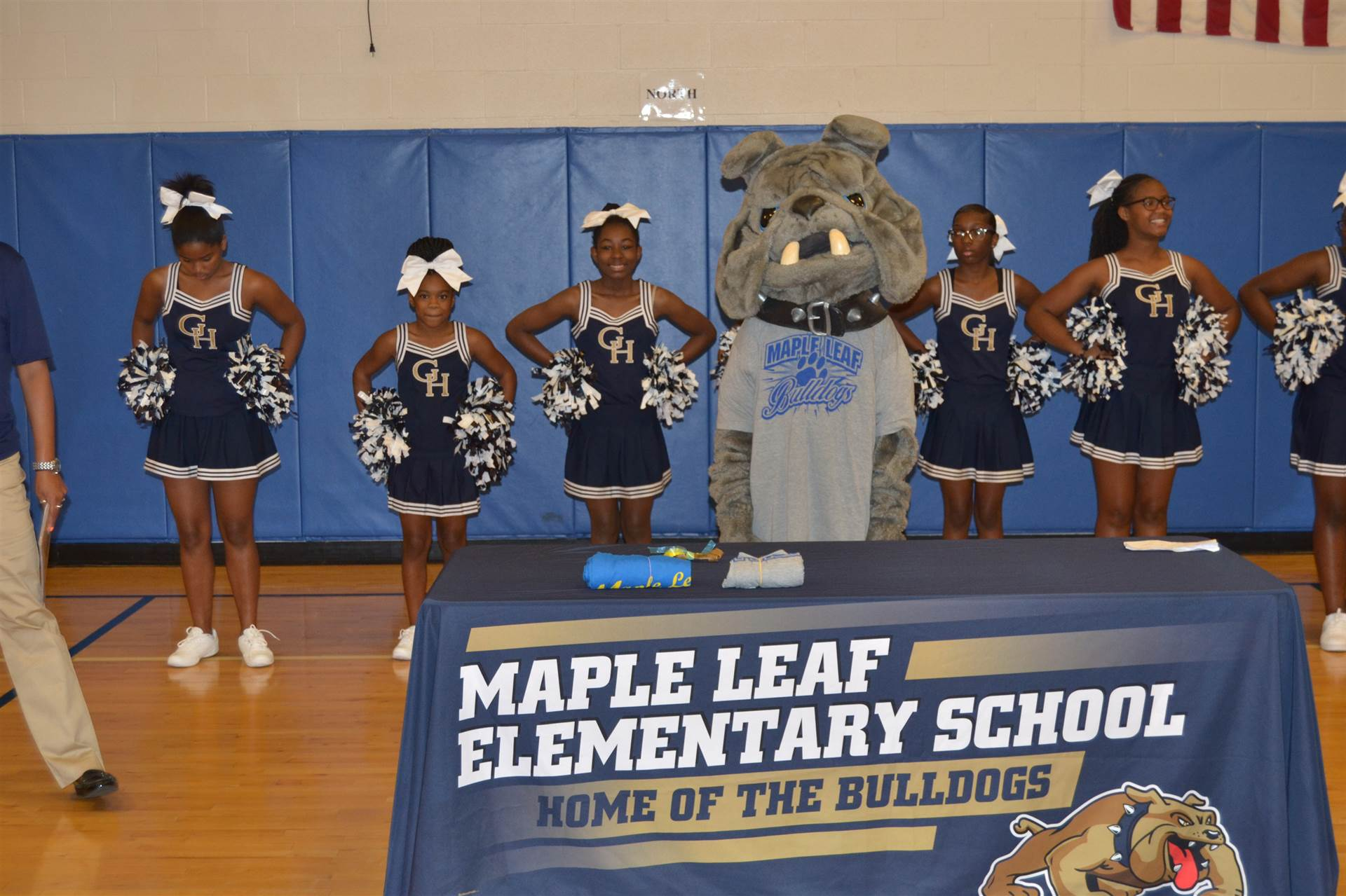 cheerleaders and the Bulldog at Maple Leaf PAWS Assembly