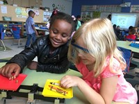 kindergarten students learning about science tools