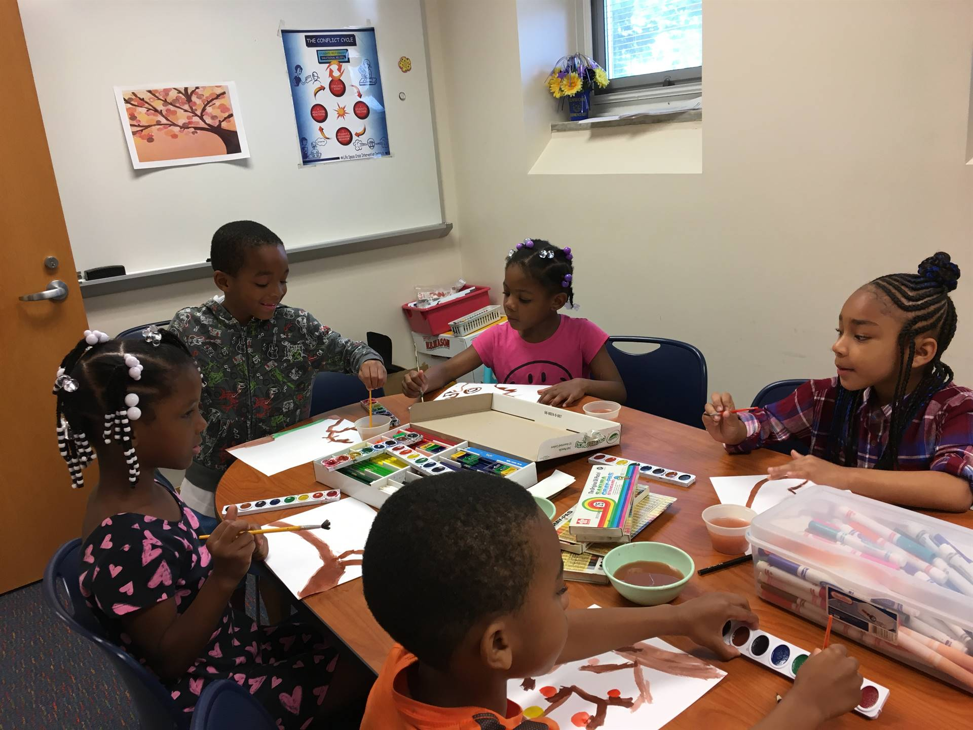 Students participating in Paint with Mrs. Harris Day