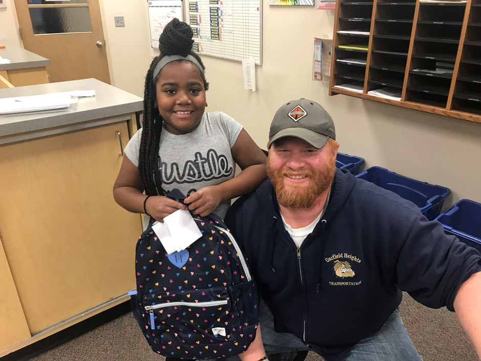 Mr. Cory bought a book bag for a student on his bus for PAWS