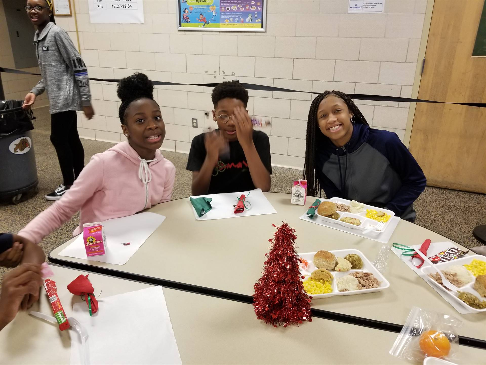 Students enjoying the feast in the cafeteria.