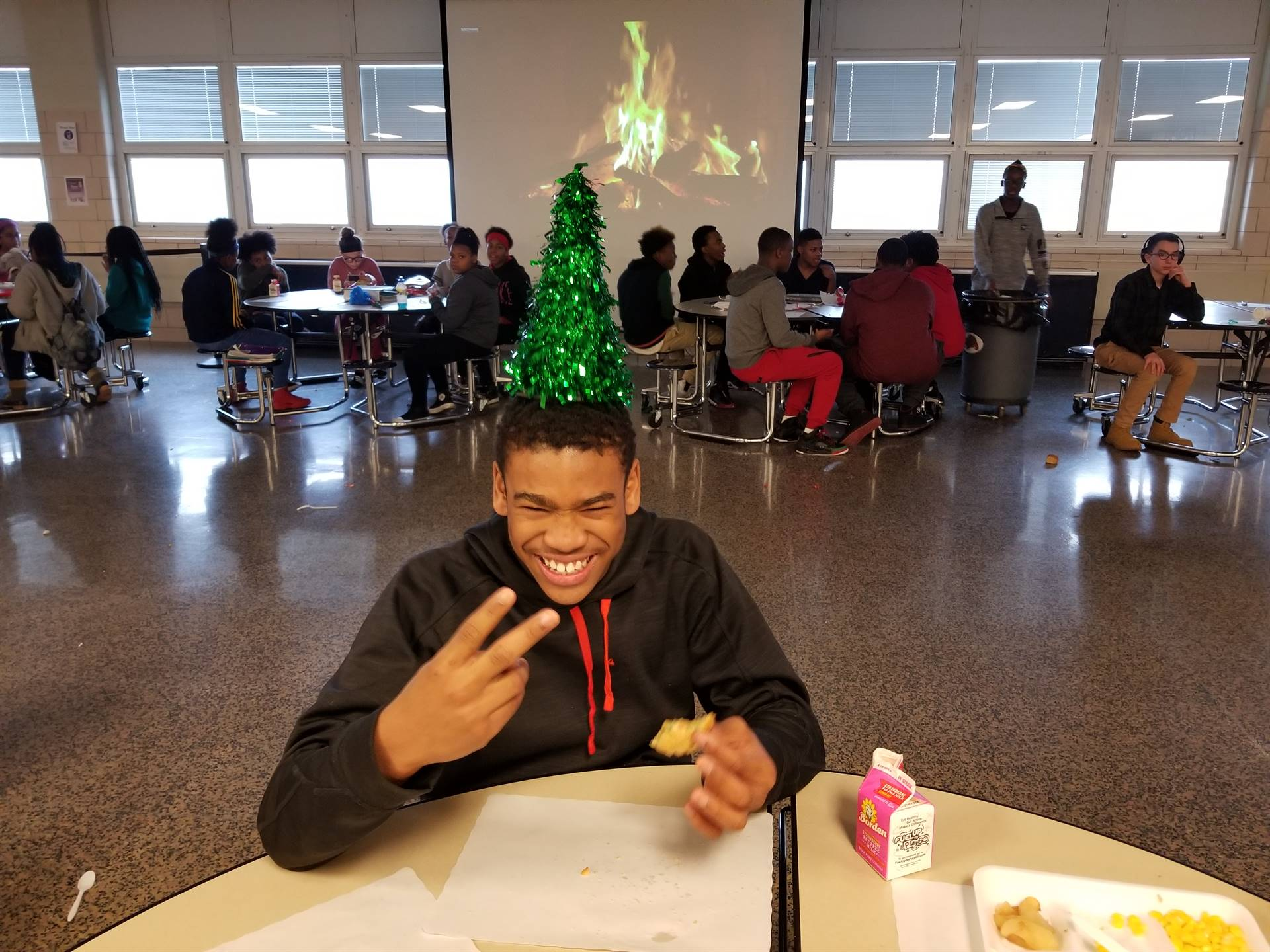 Student with tree centerpiece on his head.