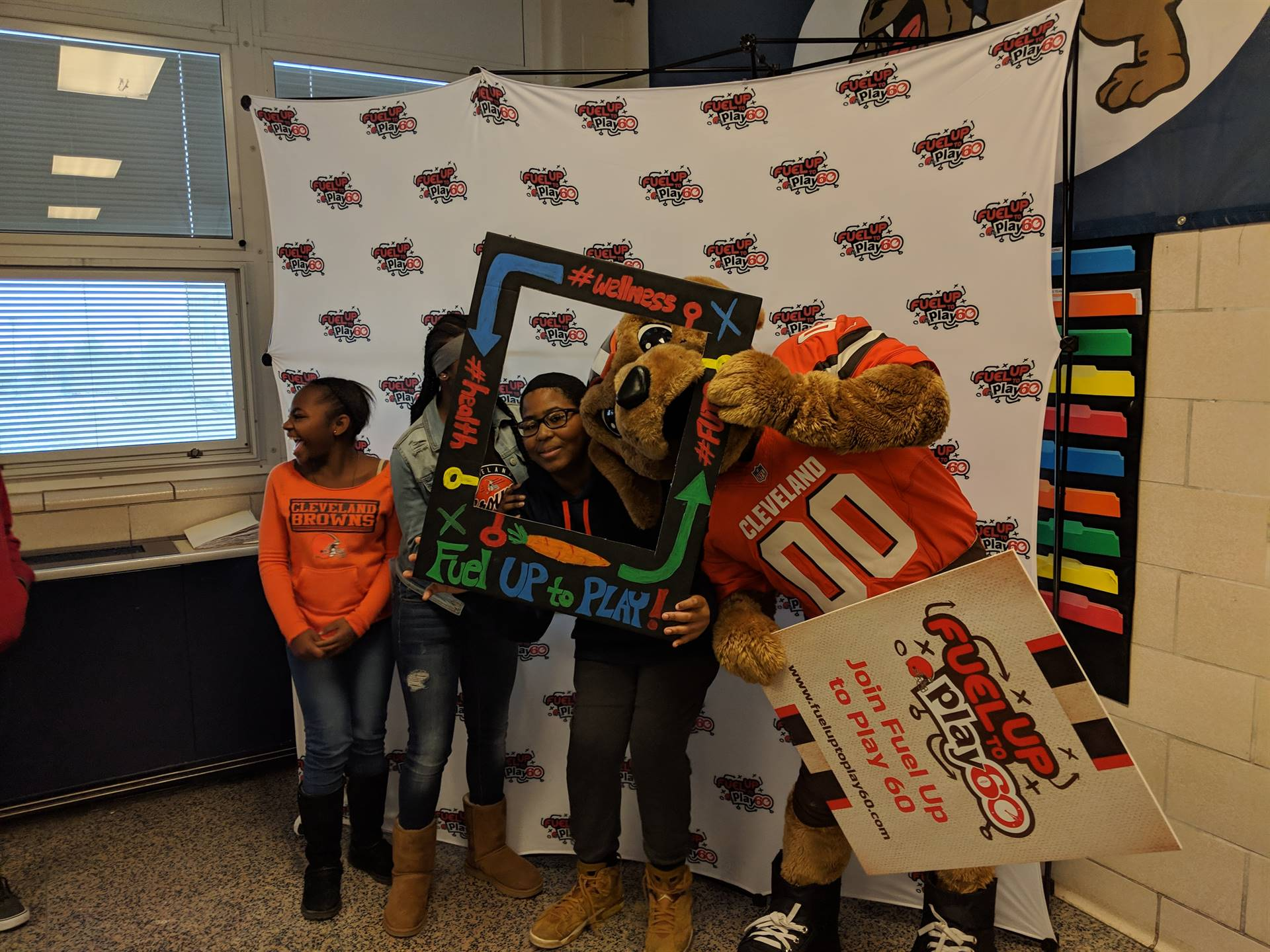 Students posing with Chomps mascot.
