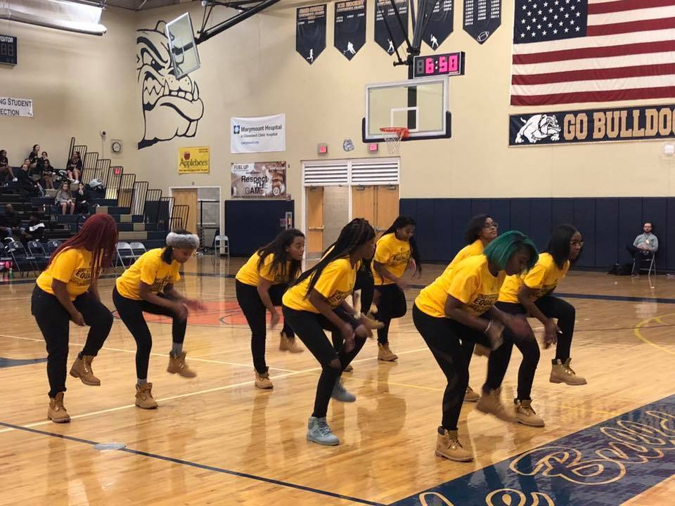Step Team posing in Black History Month t-shirts
