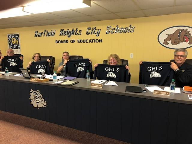 Board members showing back of new GHCS shirts