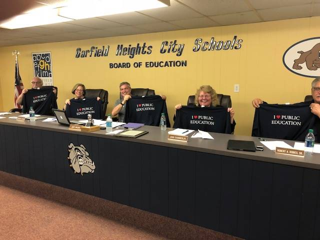 Board members showing front of new GHCS shirts