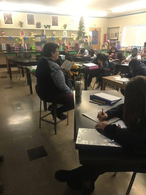Staff reading aloud during World Read Aloud Day