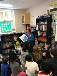 Parents reading to students during World Read Aloud Day