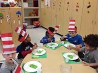 Head Start and Preschool students eating Green Eggs & Ham