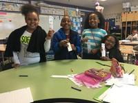 student volunteers creating bookmarks