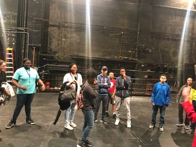 students at Playhouse for behind the scenes tour