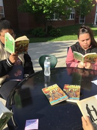Reading in the Courtyard at Maple Leaf - May 2018