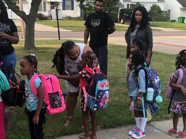 kindergarten girls line up to start school