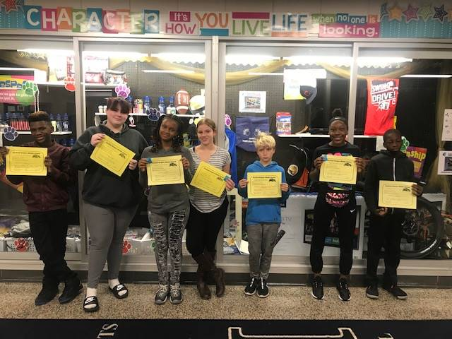 Students holding up their PBIS certificates.