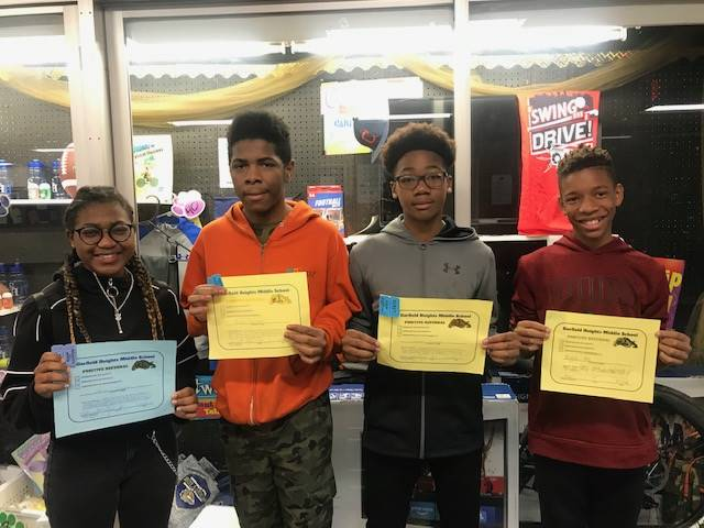 Student holding their Positive Referral Certificates