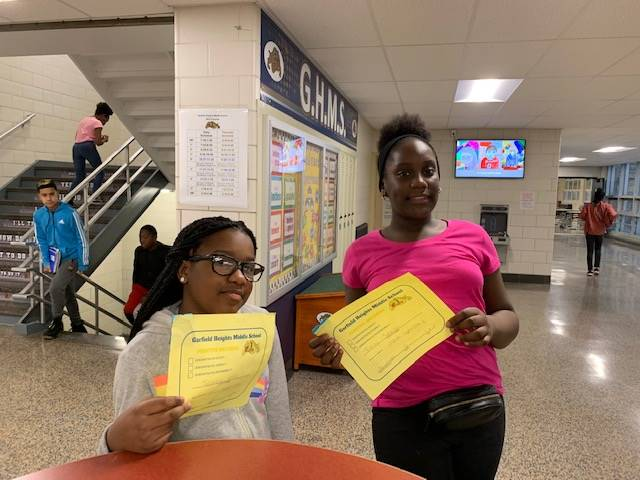 Two students with their Positive Behavior Award Certificates.