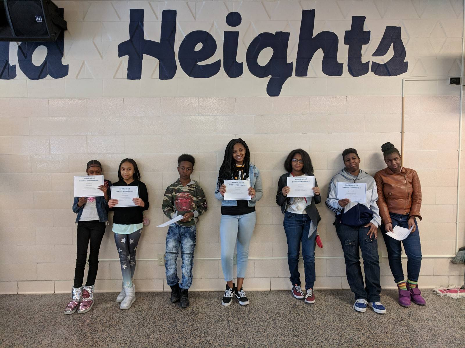 Students posing with their positive refferal forms
