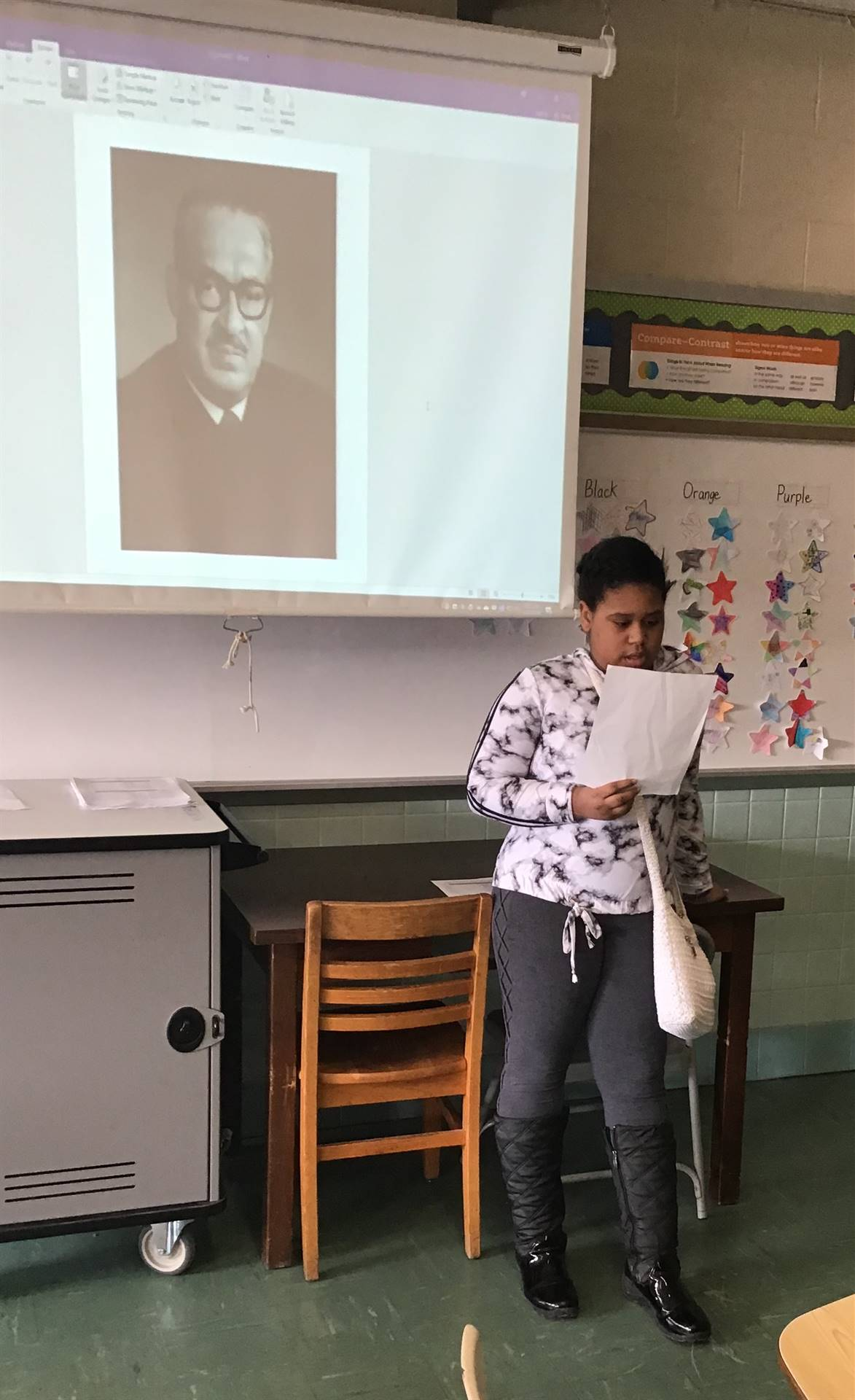 Student giving a presentation for Black History Month.