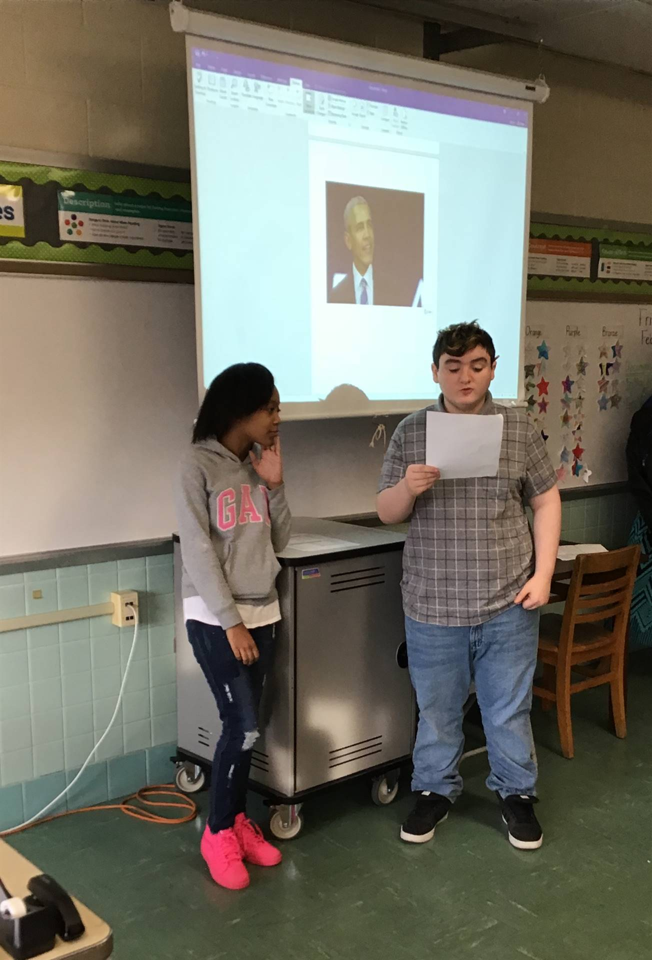 Two students giving a presentation for Black History Month.