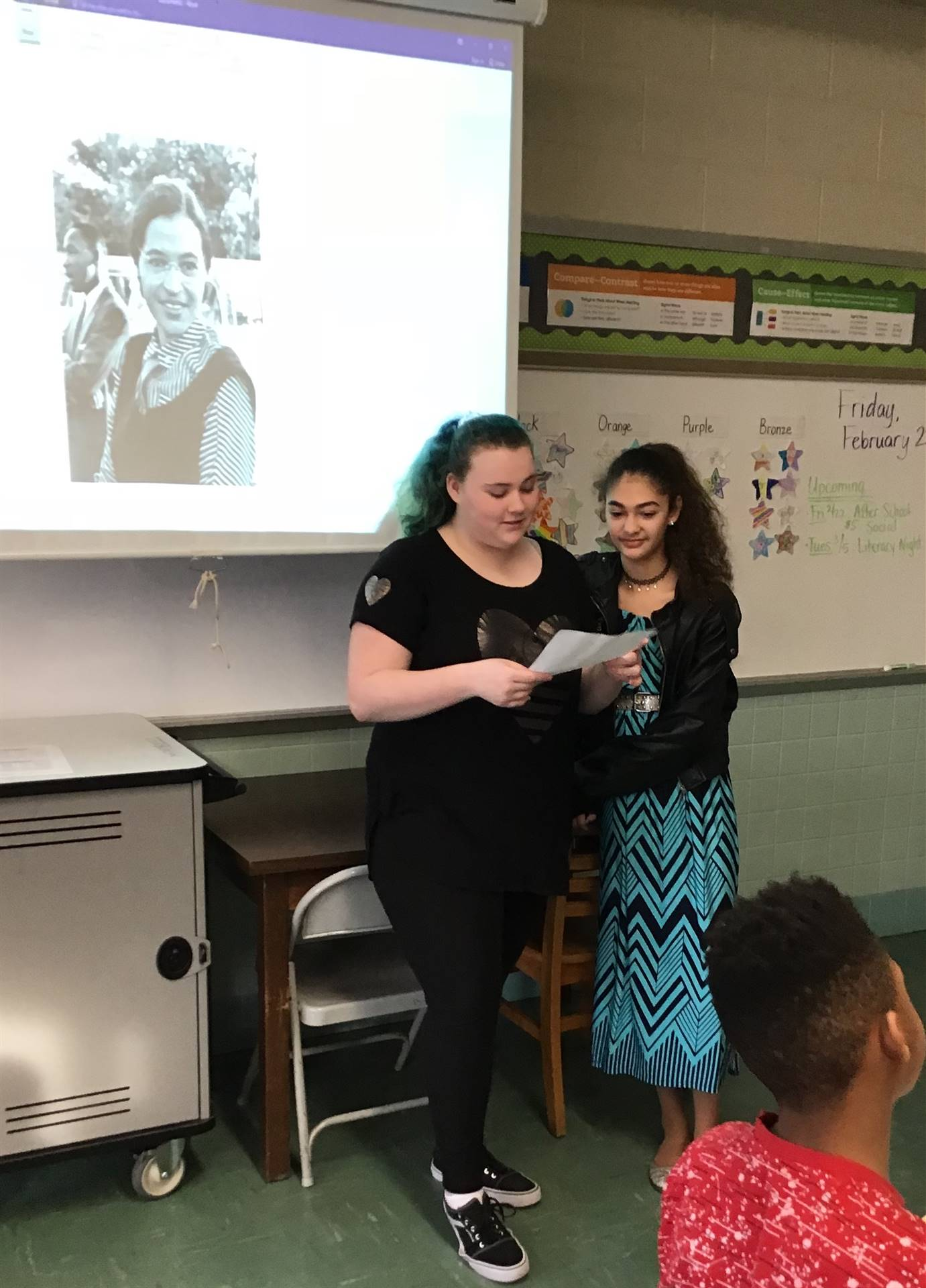 Two student giving a presentation for Black History Month