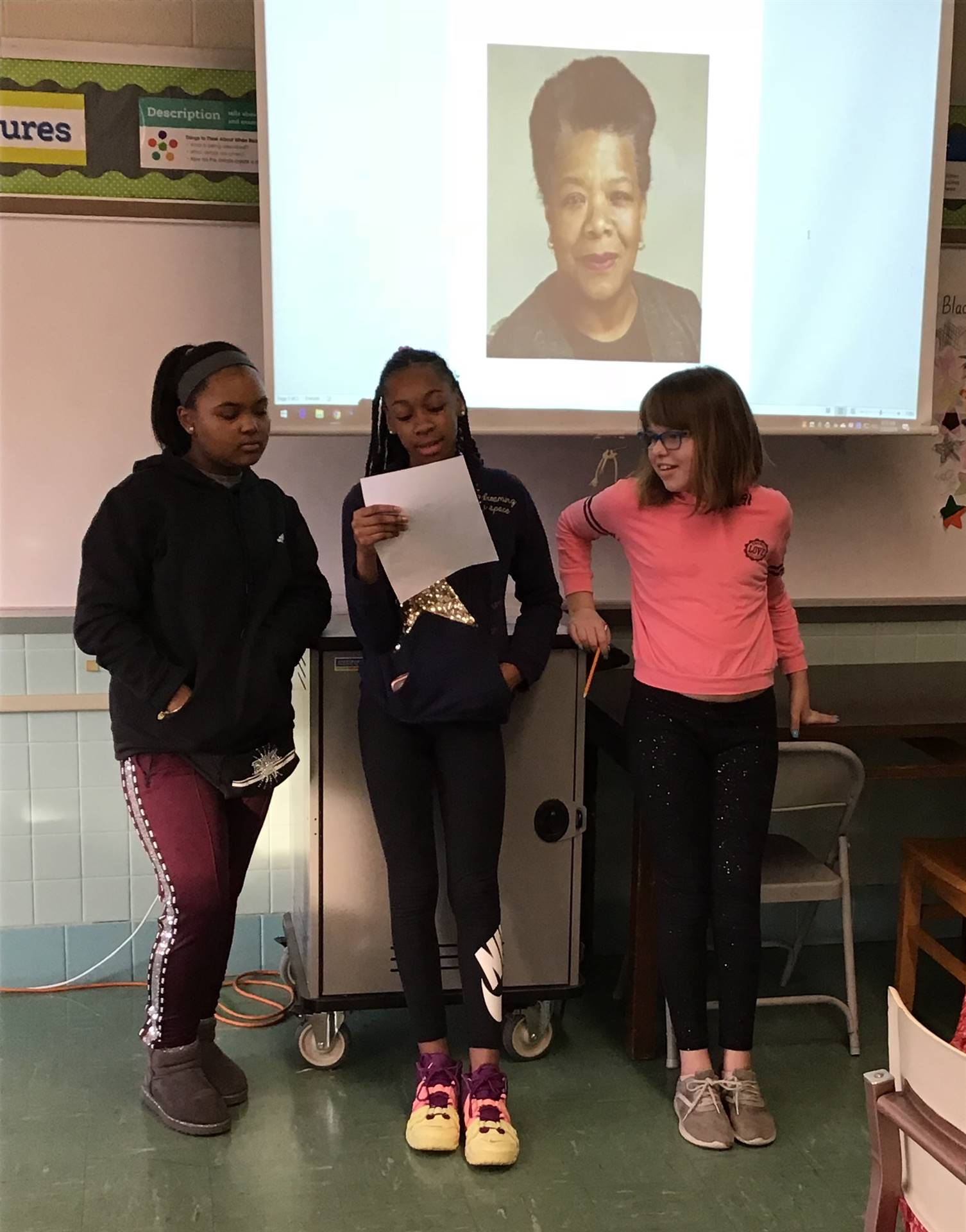 3 students presenting on Maya Angelou