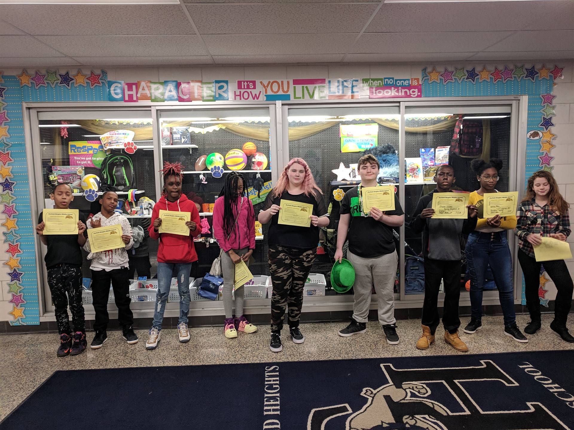 Nine students with their Positive Referral certificates