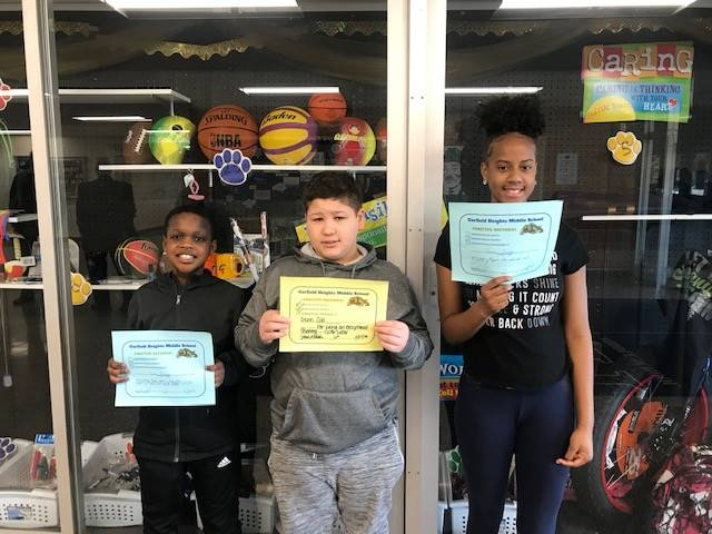 Three students with their Award Certificates.