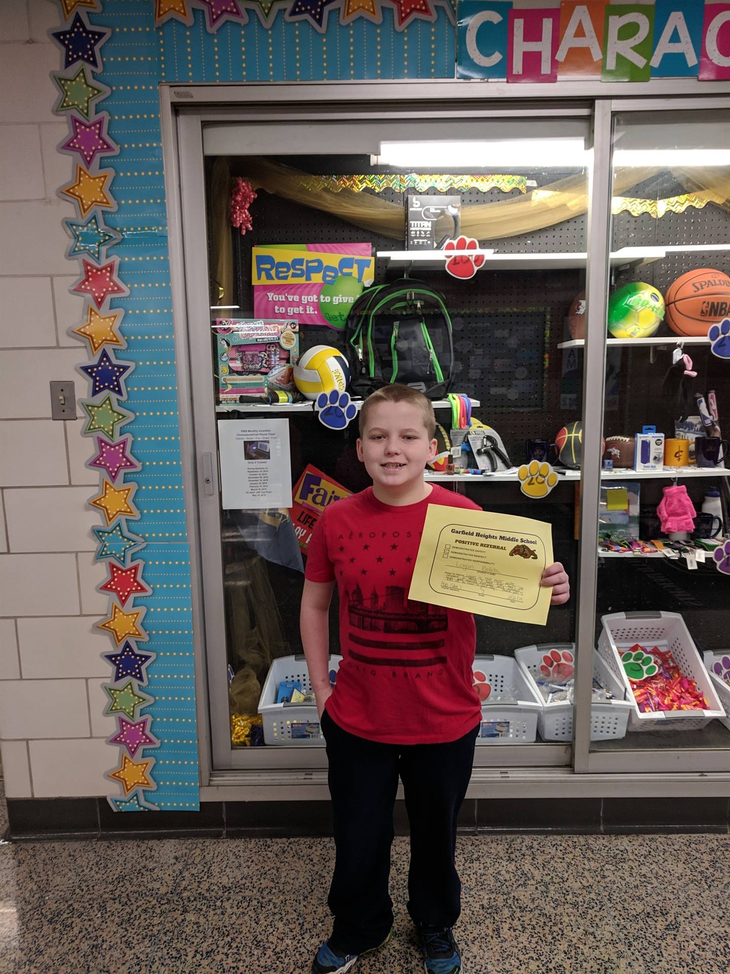 Student with his Positive Referral Certificate.