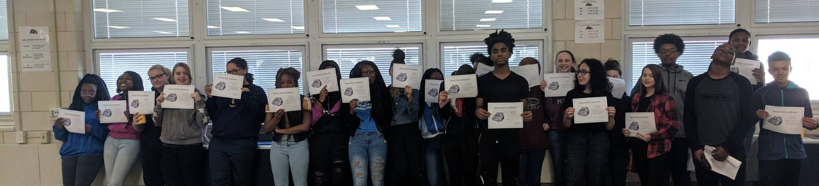 Students with Award certificates for positive behavior